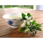 Прессованный зеленый чай с цветами жасмина.